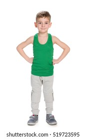 A confident little boy stands against the white background