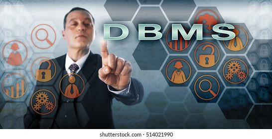 Confident male database manager pressing DBMS on an interactive control screen. Information technology concept and business metaphor for computer software functioning as database management system.