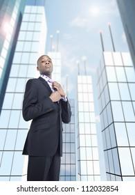 Confident male entrepreneur adjusting tie