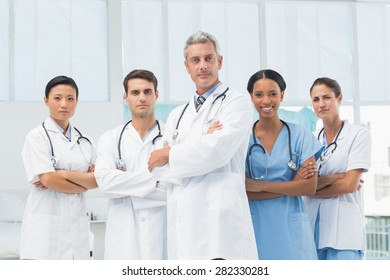 Confident male and female doctors at medical office