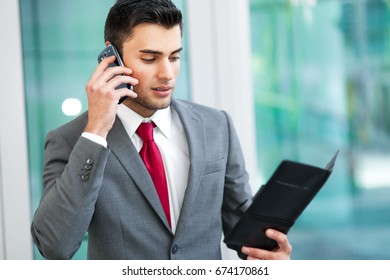 Confident male manager outdoor talking at the phone