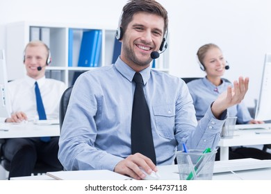Confident male telemarketer during phone call at work