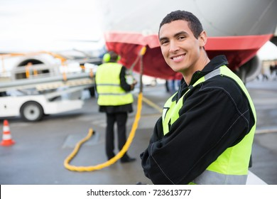 Confident Male Worker Smiling While Airplane Being Charged At Ru