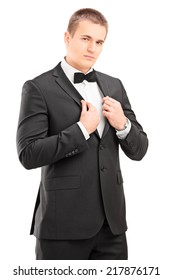 Confident man in a black suit posing isolated on white background