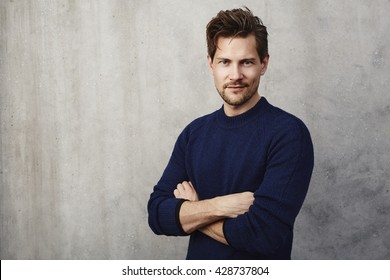 Confident man in blue sweater, portrait