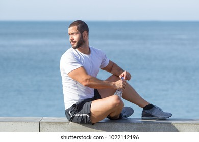 Confident Man Relaxing after Sport Training at Sea