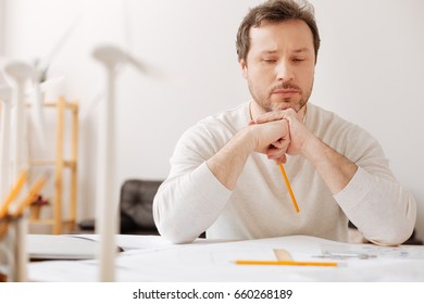 Confident man thinking about his project