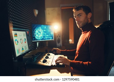 Confident Man Video Editor Works with Footage in Creative Office Studio.