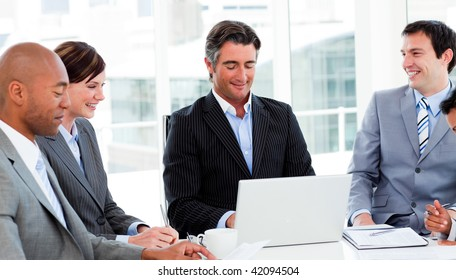 Confident manager in a meeting with his team. Business concept.