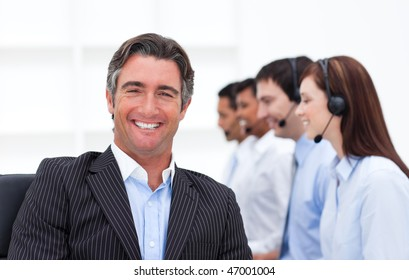 Confident manager presenting a call center in company