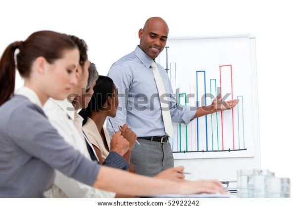 Confident manager presenting a chart explaining the results to his team in a company