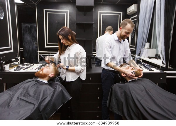 Confident mans visiting hairstylists in barber shop.