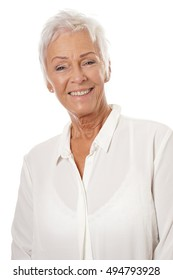 confident mature woman in her sixties wearing white blouse