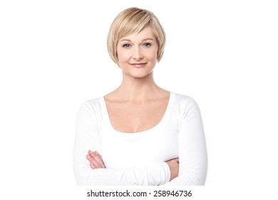 Confident middle aged woman posing to camera
