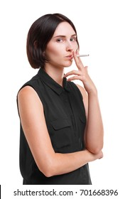 Confident office woman with a cigarette. An attractive girl is smoking isolated on a white background. Smoking concept.