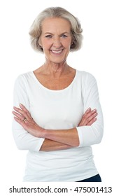 Confident old lady posing with folded arms.