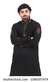 confident Pakistani Indian Muslim Arabic boy standing with arms crossed isolated over white background with serious face with out glasses in black kameez and shalwar. Muslim look.