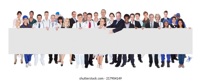 Confident people with various occupations holding blank banner over white background
