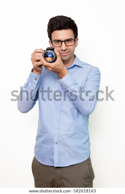 Confident photographer preparing to make photo