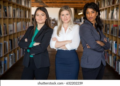 Confident portrait of a team of professional women at the workplace standing proud and intimidating