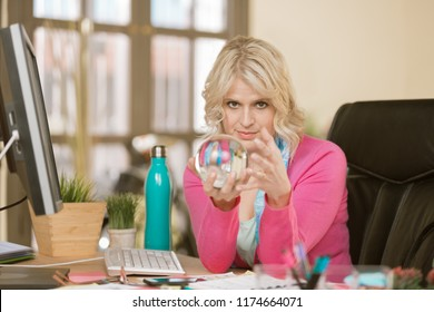 Confident professional woman with a crystal ball