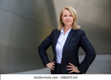 Confident proud successful business woman portrait, standing with confidence