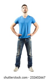 Confident proud young male in akimbo pose. Full body length isolated over white background.