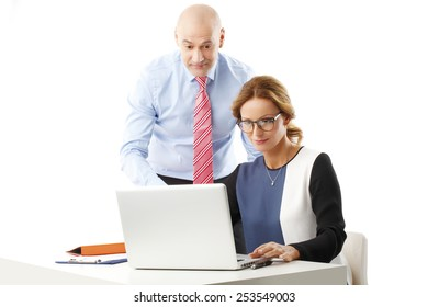 Confident sales woman presenting her idea to senior manager. Isolated on white background.