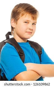 Confident schoolboy with backpack smiling looking at camera