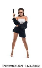 Confident seductive woman in black jacket with gun