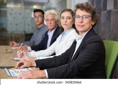 Confident senior businesswoman at conference