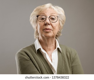 Confident senior lady looking at camera with disdain