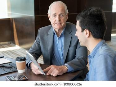 Confident senior manager setting tasks to employee