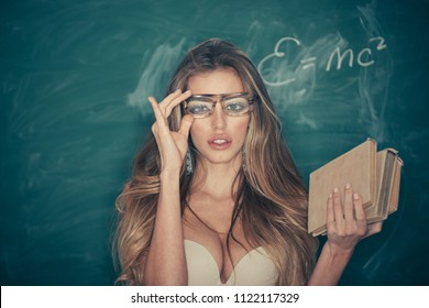 Confident and sexy teacher. Sensual woman adjust glasses on makeup face. School and education for adult. Woman with long blond hair in bra pose at chalkboard. Sexi bookworm. Back to school.