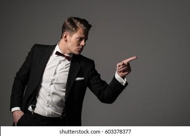 Confident sharp dressed man in black suit.