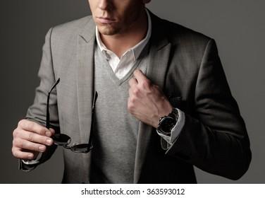Confident sharp dressed man in grey suit