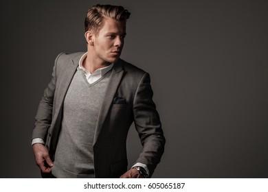 Confident sharp dressed man in grey jacket.