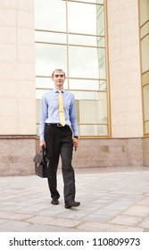 Confident smiling businessman walking to work