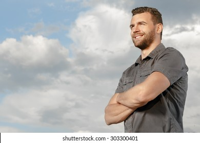 Confident, smiling man outdoors