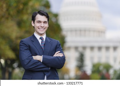 Confident Smiling Man Standing In Front Of US Capitol
