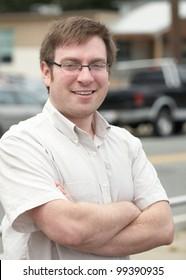 Confident smiling young man outdoor portrait