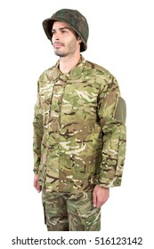 Confident soldier standing against white background