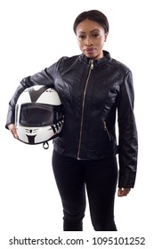 Confident strong black female holding a helmet as a race car driver, motorcycle biker or a stuntwoman.  The image depicts feminism by portraying a gritty woman of extreme motorsports.