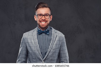 bdc2a1753408 Confident stylish bearded man with hairstyle in an elegant retro gray suit  and bow tie,
