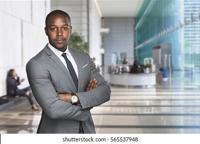 Confident stylish handsome professional banker at financial work space workplace