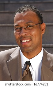 An confident and successful African-American businessman in a power suit