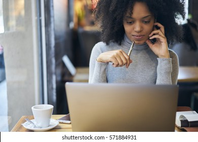 Confident successful female administrative manager of trading corporation making online parley with business partners discussing details of collaboration using laptop computer and free wifi connection