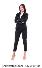 Confident successful independent strong business woman with crossed arms in elegant suit. Full body isolated on white background.