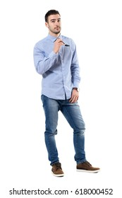 Confident successful smart casual businessman holding sunglasses looking at camera. Full body length portrait isolated over white background.