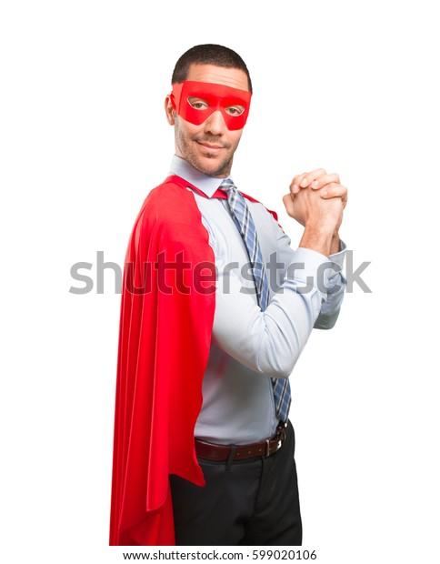 Confident super businessman doing a teamwork gesture